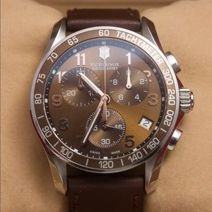 Brown leather Victorniox Watch. Brand new!!